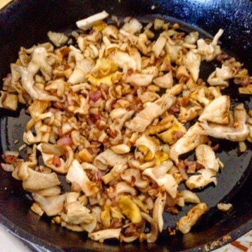 In bacon grease, cook mushroms, shallots, and garlic until browned